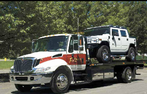 falzone truck moving a white hummer