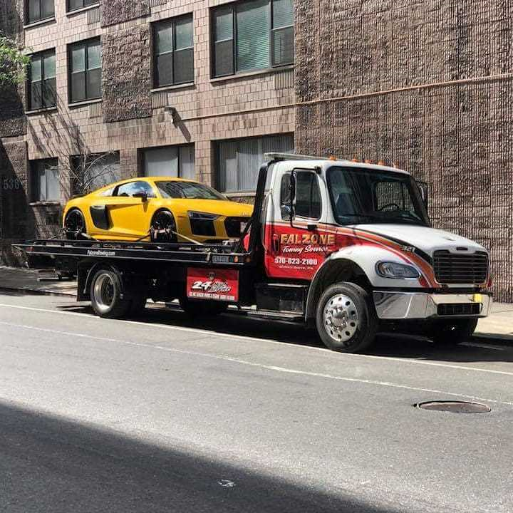 321 truck towing an audi