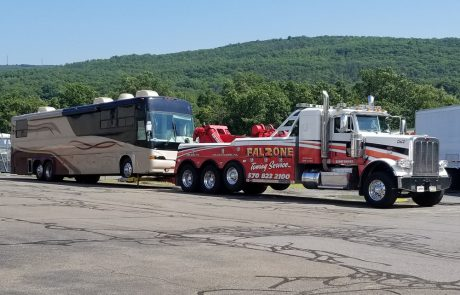 Tow truck hauling RV