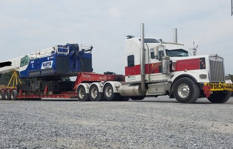 Truck towing large crane