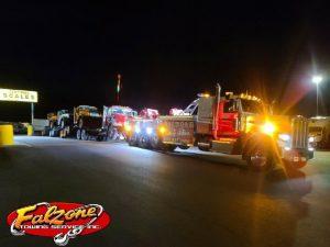Semi Tow Truck Tows 4 HUGE Trucks 1